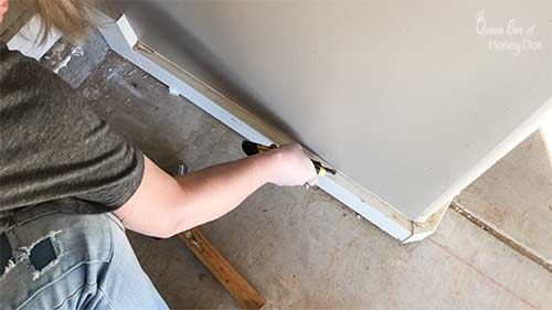Step 1 of removing baseboards.