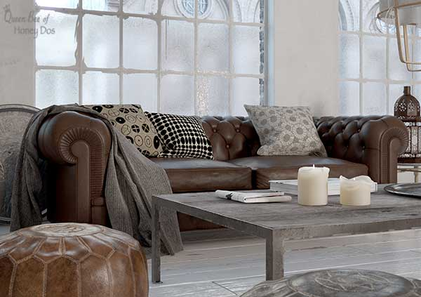 leather sofa decorated with pillows