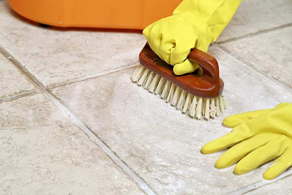 scrubbing tiles and grout