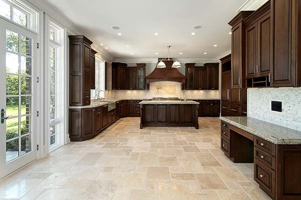 Kitchen with travertine tile in versailles pattern.