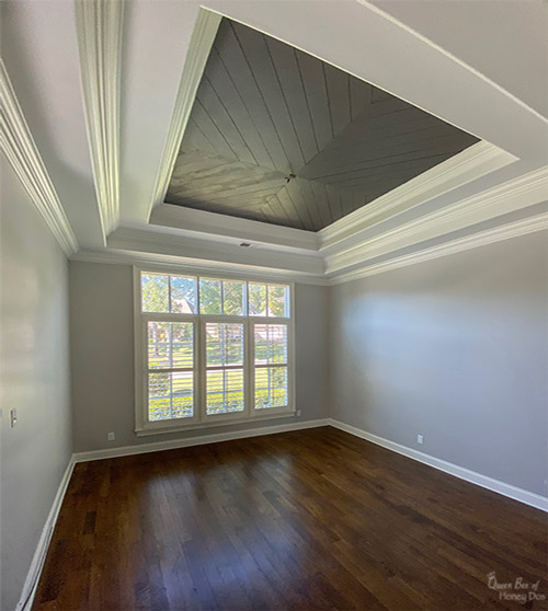 room with chevron plank ceiling