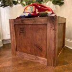 Wooden Christmas tree stand that looks like a Shipping Crate with shipping stamps