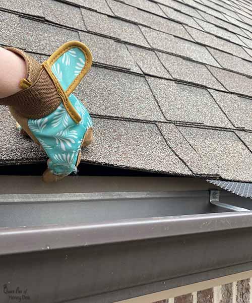 lifting roof shingle