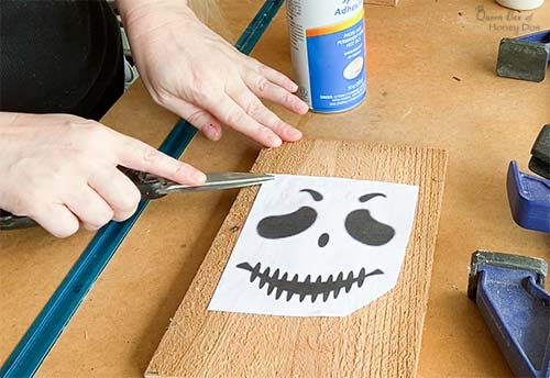 attaching Halloween face pattern to lantern front