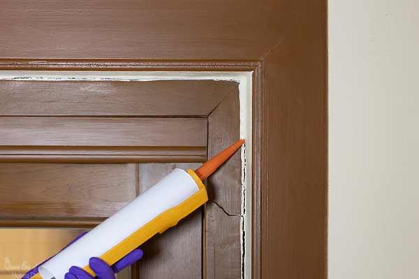 caulking around door cracks