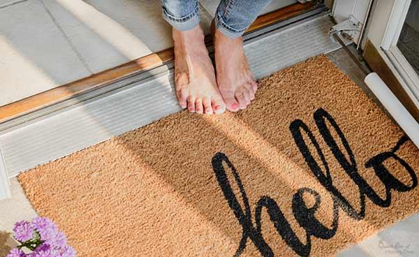 woman's feet standing at door threshold