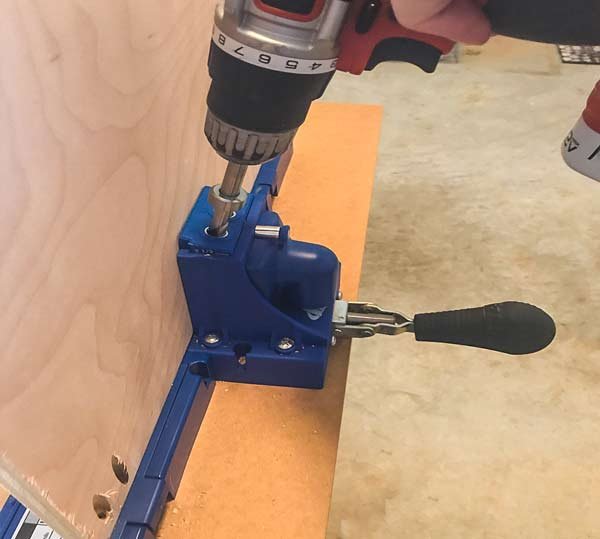 Kreg K5 being used to drill holes in plywood