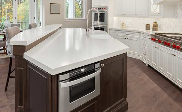 kitchen island with a microwave drawer